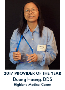 Duong Hoang holding award with blue lettering under the image reading 2017 Provider of the Year Duong Hoang, DDS Highland Medical Center