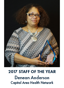 Denean Anderson holding an award with blue lettering under the image reading 2017 Denean Anderson Capital Area Health Network